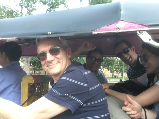 Five people in a tuk tuk